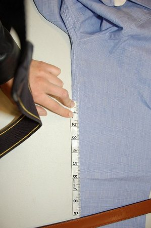 tailor measuring dress shirt