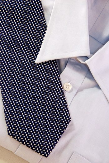 men's blue shirt and tie